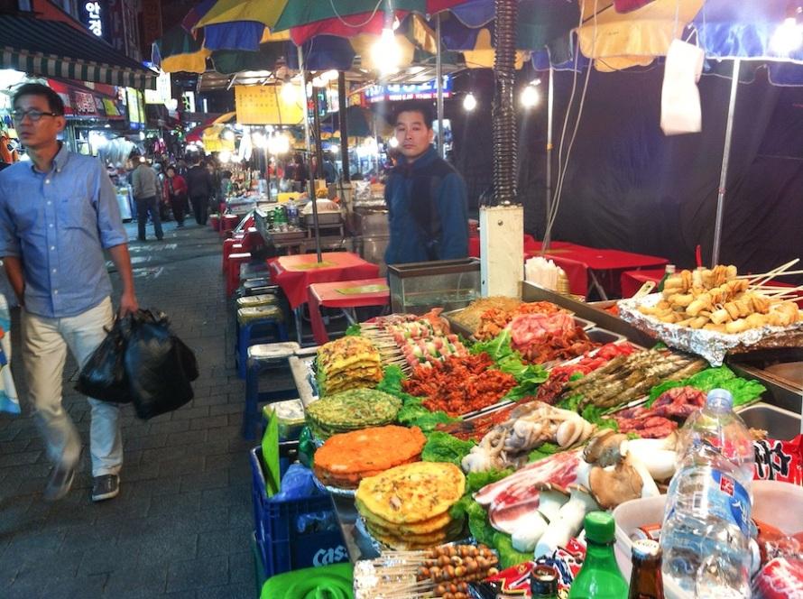 Multiple street vendors lined up at Namdaemun Market.
