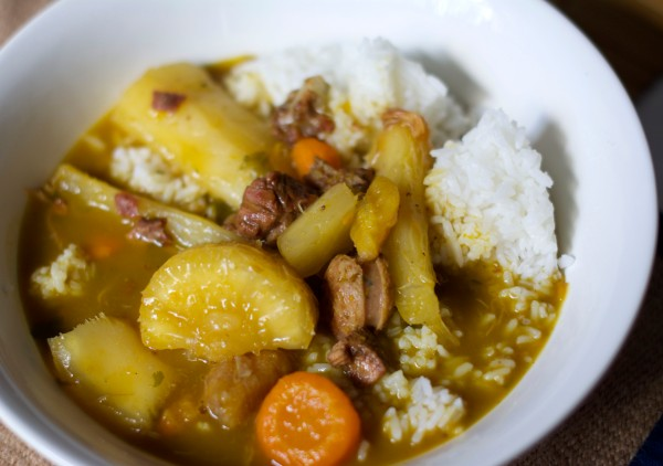 Sancocho is a hot stew made largely of meat and vegetables. Here, my sancocho is pictured with rice, yuca, and goat.