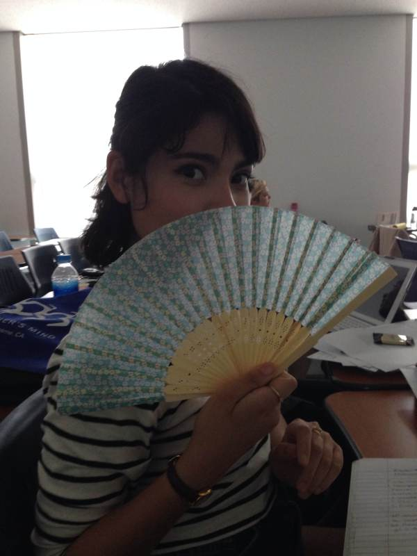 A fellow intern English teaching modeling my fan.