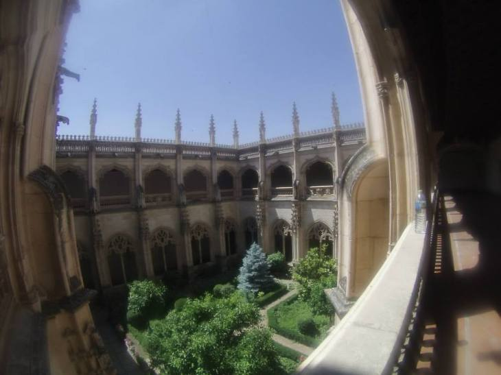 The courtyard in the monastery was very colorful and the monastery had very symmetrical architecture.