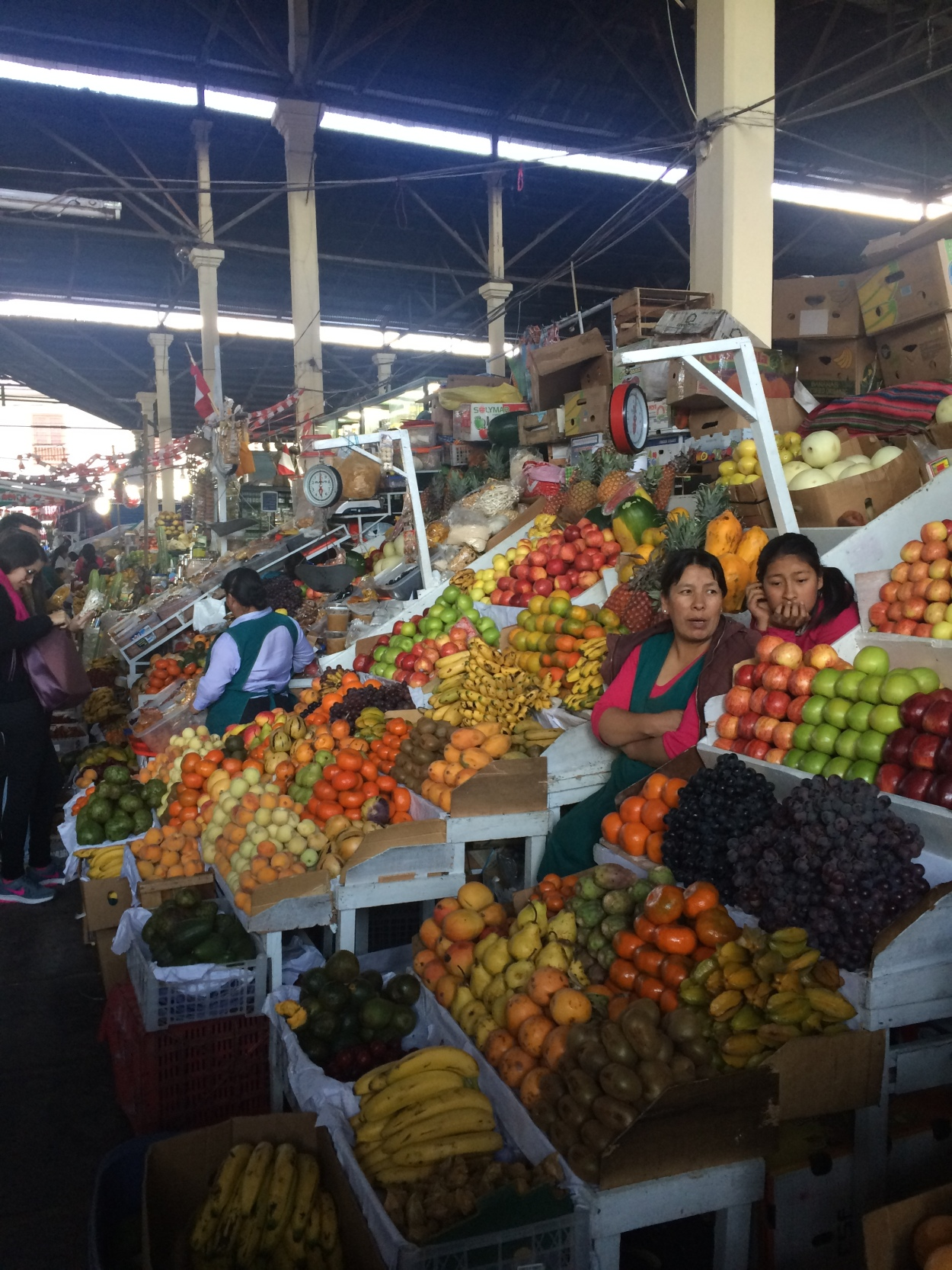 Sampling new fruits at a market in Cusco