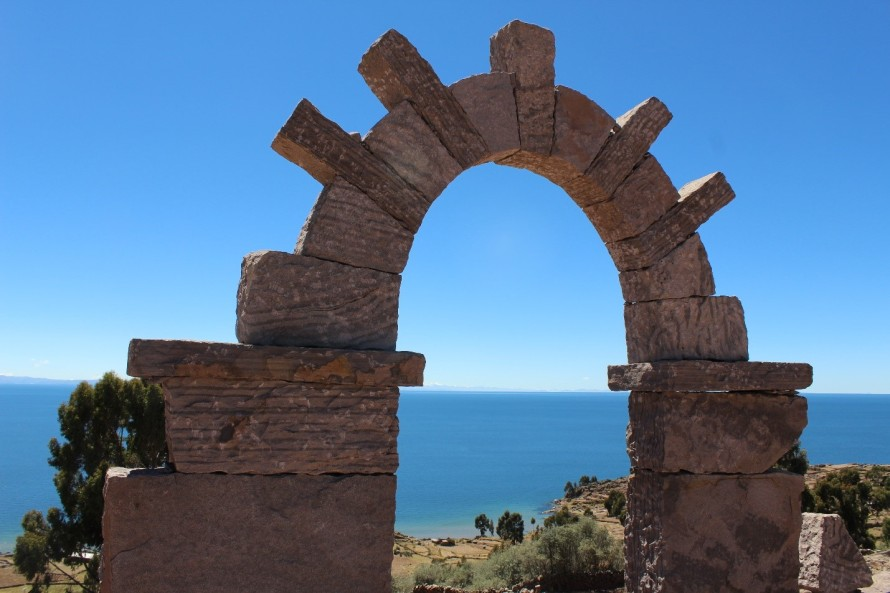 Lake Titicaca and the Taquile Island can be seen through the archway