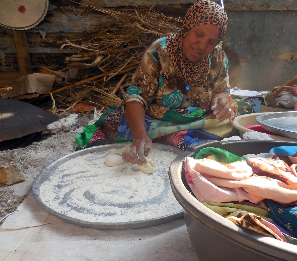 Madia prepares dough to be made into flatbread.