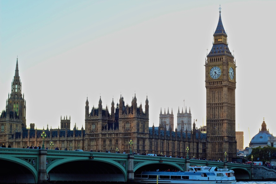 Big Ben, Houses of Parliament, and Westminster Abbey, all resting along the Thames River.