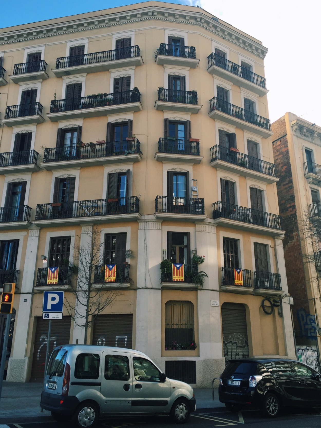 Catalonian flags share space with Catalonian independence flags on balconies everywhere in Barcelona!