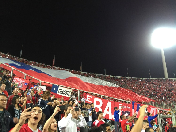 Fans raise the Chilean flag during the National Anthem.