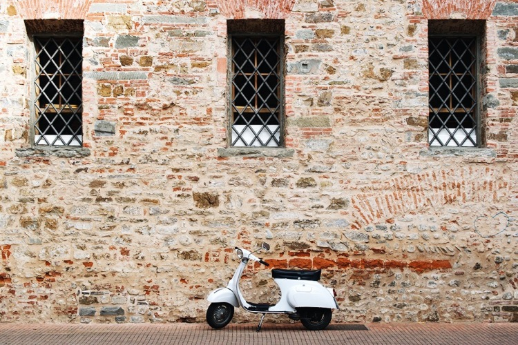 A lovely white Vespa parked in the courtyard of Le Murate Caffè Letterario