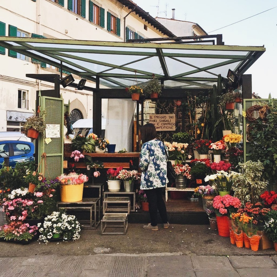 Enjoying springtime at a flower market near Loggia Del Pesce