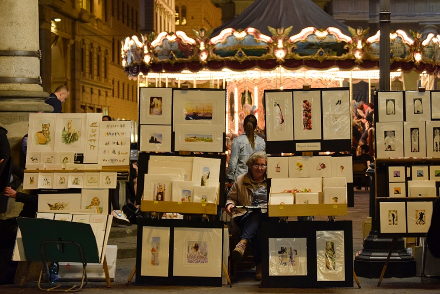 Small watercolor paintings of Florentine landscapes on display at Piazza Della Repubblica