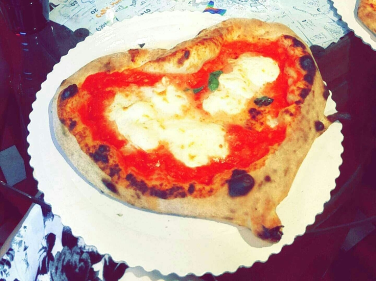 Heart-shaped Margherita pizza from Gusta Pizza in Florence.