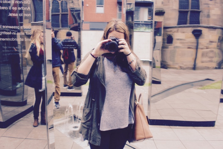 girl taking photo in mirror at st andrews cathedral glasgow