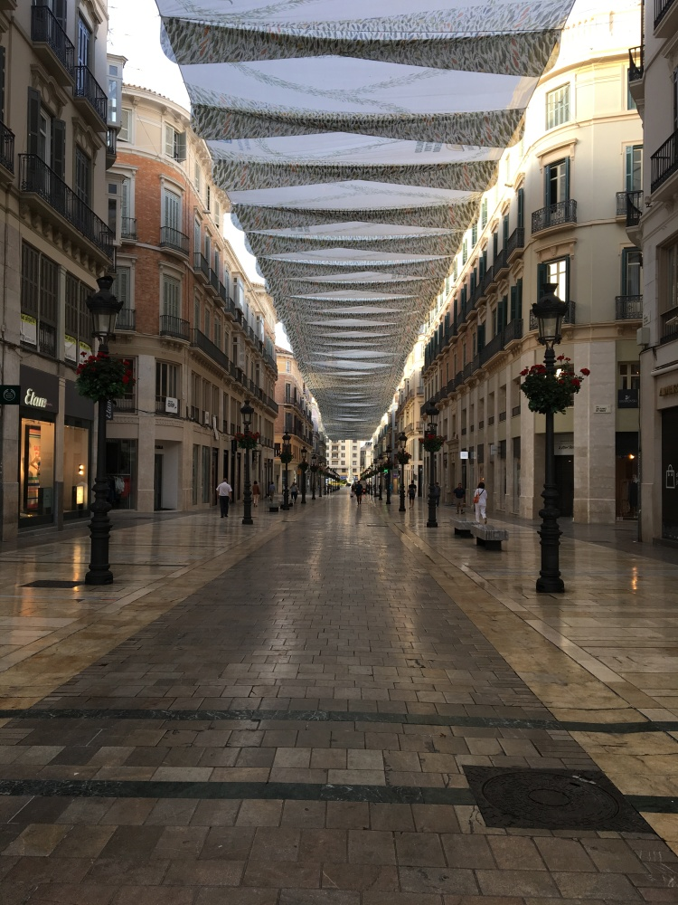 The morning walk to the bus stop isn't too bad when you walk through Calle Larios, one of the main shopping strips in Malaga.