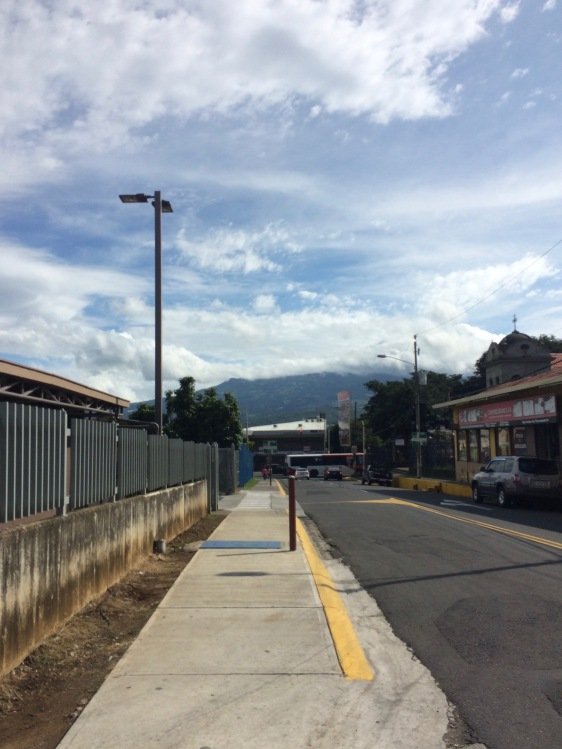 My classmates and I walk up and down this street every day to get to the bus stop. The beautiful mountains have been visible nearly every morning. On the left of this street is a Wal-Mart, but the best part of this walk is looking up above the houses and businesses and admiring the surrounding mountains. Each day walking to class, I notice something new and charming about this city.