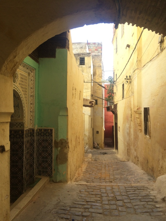 An alleyway in the old medina of Meknes depicts the city's ability to maintain traditional and historical charm without blockading technological and cultural diversity.
