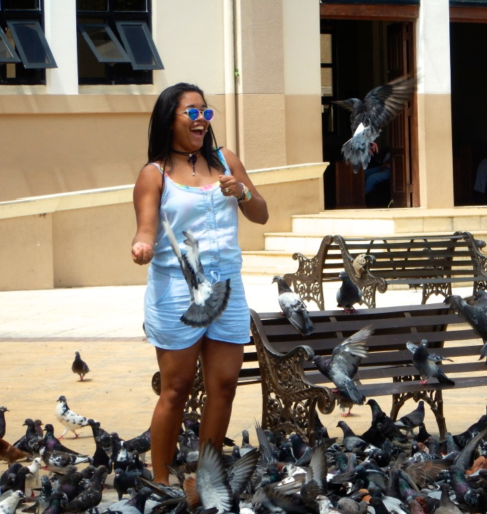 My friend Ani, playing with the pigeons at the square in Puerto Plata