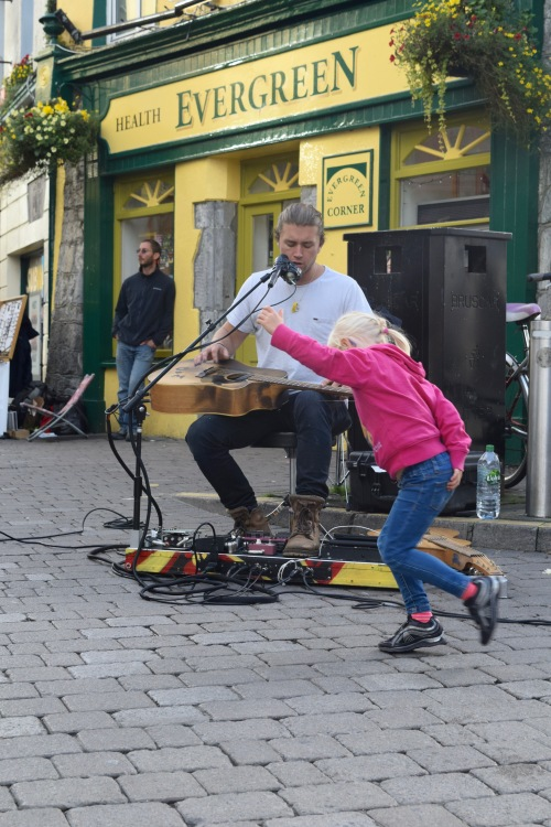 One of the many street musicians I've encountered throughout my travels and his biggest fan. Found playing on the streets of Galway.