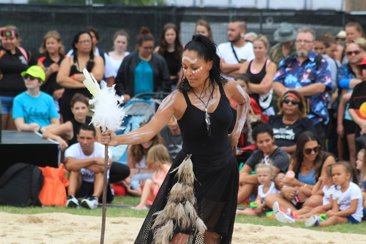 A young lady from the Blue Mountains dances in dedication to the cockatoo.