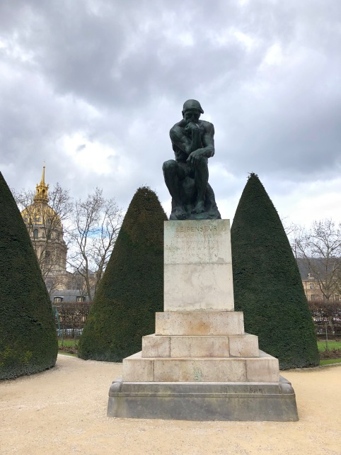 """The Thinker"" found in gardens of the Rodin Museum."