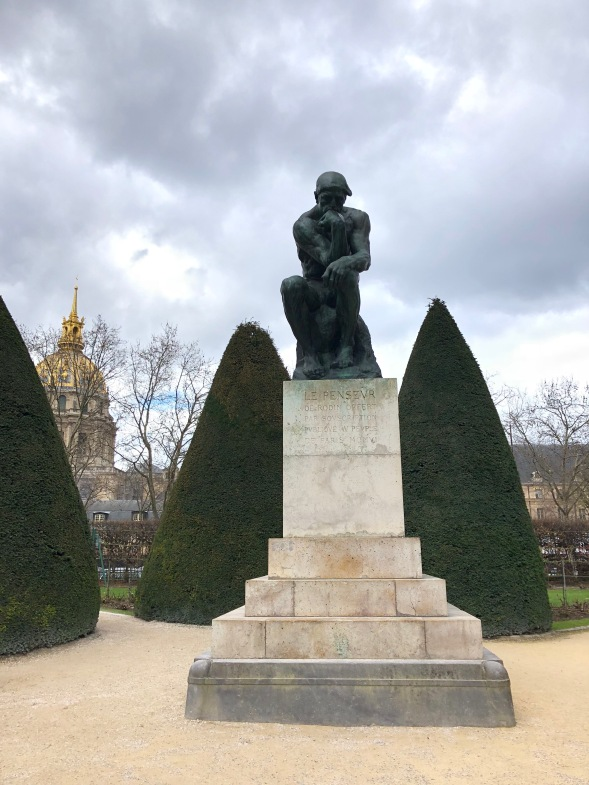 """""""The Thinker"""" found in gardens of the Rodin Museum."""