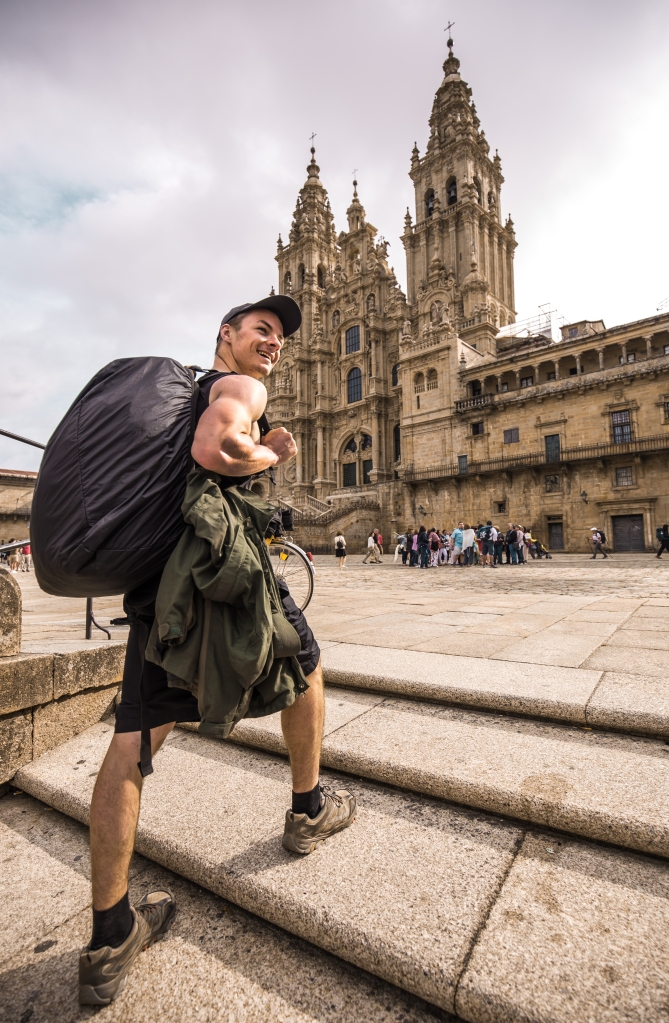 person backpacking to cathedral santiago